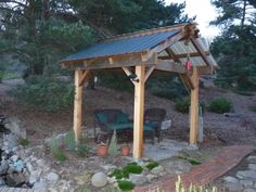 Pergola with a tin roof for listening to the rain