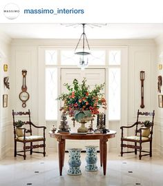 Blue and White Monday from Instagram. Classic entry with round table displaying a lush centerpiece.