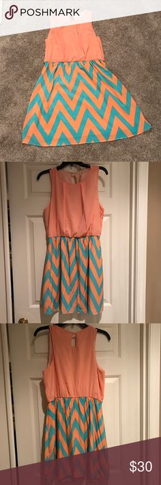 """Pink Owl Dress Coral/ tangerine and aqua blue dress with herringbone pattern on bottom half. Hits a little bit above the knees, I am 5'6"""". The back has a little button at the top. Only worn once. Pink Owl Dresses"""
