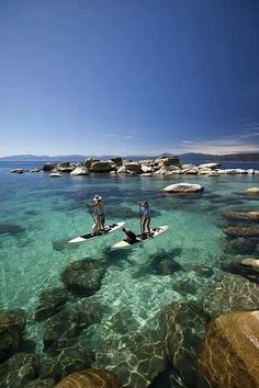 Stand-up paddle board in crystal clear water.