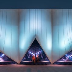 DUS Architects has combined 3D-printed bioplastic with a tensile fabric structure to create a sculptural facade for a temporary European Union building