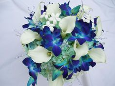 .Crystals for our Bride Crystal.  Crystal's bouquet is designed with blue orchids, aqua hydrangeas, white mini calla lilies and tear drop crystals.