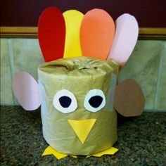 My daughter Elise just made this cute turkey decoration out of a toilet paper roll... So cute!