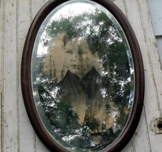 remove some silver from the back of an old mirror and replace with a vintage picture.