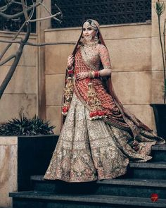 Looking for A Sikh bride in a metallic color lehenga wearing kaleere and antique jewellery? Browse of latest bridal photos, lehenga & jewelry designs, decor ideas, etc. on WedMeGood Gallery. Wedding Lehnga, Indian Bridal Lehenga, Indian Bridal Outfits, Indian Bridal Fashion, Indian Bridal Wear, Pakistani Bridal, Indian Dresses, Red Lehenga, Saree