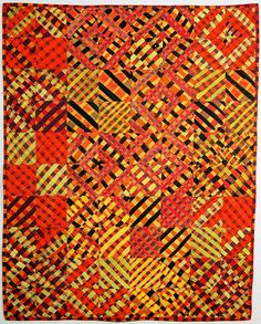 I batiked, dyed, cut up and pieced all the fabric in this piece. The color palette was very limited and reminded me of African kente cloth.