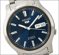 """Seiko Men's SNK793 """"Seiko 5"""" Stainless Steel Blue Dial Automatic Watch An exhibition back exposes the mechanisms of this Seiko watch, whose automatic movement maintains reliable time without need of a battery.. With its automatic self-winding movement, this analog-display watch never needs a battery.. Protective Hardlex crystal dial window. Features push-button deployment clasp, stainless steel construction, and date and date window at three o'clock position. Water-resistant to 30 m (100…"""