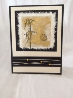 beautiful handmade card .. Oriental theme ... luv the feathered edges on the mulberry paper matted focal point ... black with neutrals ...