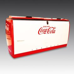 1950's Westinghouse Coca-Cola Chest. Now fitted with a brand new refrigeration unit and adapted to a UK power supply, the Westinghouse functions as a fully-operational fridge, chilling its contents to the optimum drinking temperature. The chest has a built in bottle opener on the front, which deftly opens the bottle whilst allowing the cap to freefall down a hidden chute into the removable drawer at the bottom. | The Games Room Company