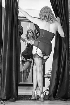Old Hollywood Glamour from the divine Doris Mayday in our Glamour Nouveau Merry Widow. This delicious basque is available in both sleek black satin and delicate vintage peach, with four suspender straps, removable shoulder straps and a shaping waist tape to cinch in your waist for that vintage wiggle! Available in sizes 32-38 B-E. Hair by Miss Rockabilly Ruby.