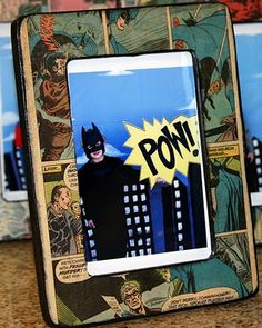 DIY comic book frames: buy a plain frame from a craft store, paint it black, and then decoupage comic pages onto it.