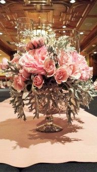 Silver footed vase with lush pinks and dusty miller WWW.Efilasvegas.com