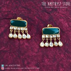 A pair of silver with gold studs is studded with semi-precious stones. Gold Jhumka Earrings, Jewelry Design Earrings, Gold Earrings Designs, Gold Jewelry Simple, Stylish Jewelry, Fashion Jewelry, Indian Jewelry Sets, Silver Jewellery Indian, Fancy Jewellery