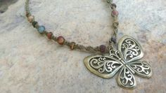 Check out this item in my Etsy shop https://www.etsy.com/listing/237869734/brass-butterfly-hemp-necklace-jasper