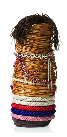 Africa | Fertility doll from the Sotho people of South Africa | Conical wooden core, coated with cloth, twisted grass fibre rings and bead bracelets, decorated with strings of glass beads, coiffure of dyed plant fibre | The skill of making dolls is passed on from the mother to the daughter