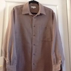 """Tan / Light Brown Blouse Tan / Brown button down blouse with one breast pocket. 100% Polyester, but looks and feels a little like suade. The size is large but fits more like an XL- it is a nice """"big shirt"""" .  Gently worn & loved. Apt. 9 Tops Blouses"""