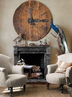 The vivid blue feathers of this stuffed peacock provide a stunning contrast to this living room's neutral palette. #decoratingideas #livingrooms