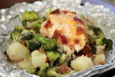 Foil PackChicken |  About 1.5 pounds of diced red potatoes,  4 boneless, skinless chicken breasts (6 oz. each), Lawry's Garlic & Herb marinade,  4 cups broccoli florets,  1 cup shredded cheddar cheese,  4 slices of bacon, cooked and crumbled 4 Tbsp Ranch Dressing