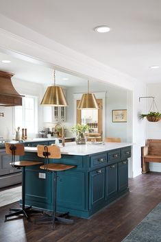 We reconfigured the space to open up the floor plan, making it easy for a family of four to all be in here enjoying baking or cooking together at once. On the island we made sure to install an island overhang for comfortable bar seating and plenty of storage.