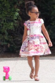 Blue Ivy Carter wearing Kitsch Kitchen Pull Along Pink Cat Toy and Ray Ban Junior Wayfarer Sunglasses