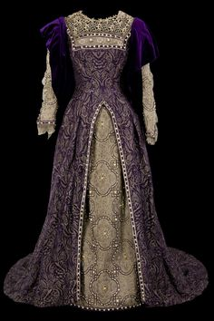 Theatre costume,  Renaissance dress. Top dress in purple and gold brocade trimmed with beads; in antique silver leaf skirt and pearls. Wimple. Draped in purple velvet sleeves. 1882