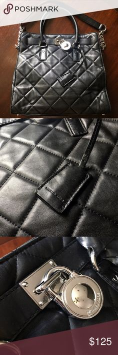 Authentic Michael Kors Hamilton Bag Authentic Michael Kors Black Quilted Leather Hamilton bag. Has some minor scratching on the bottom edges and on the lock otherwise in great condition. Leather is soft and supple and interior is immaculate. Great bag for business or pleasure. Michael Kors Bags Totes