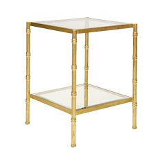 """Elegant and sophisticated, this bamboo glass top side table can add a classic touch to your home. Leave the bottom shelf open or make it your own by adding accents such as decorative books. Height 26"""""""