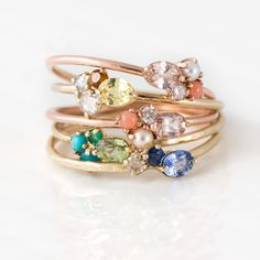 Our mini cluster rings are the perfect way to treasure a group of your favorite gemstones and birthstones while maintaining a minimal look. Choose from our colorful collection of mini cluster rings, o Jewelry Accessories, Jewelry Design, Rose Gold Engagement Ring, Schmuck Design, Halo Diamond, Or Rose, Ring Designs, Bridal Jewelry, Minerals