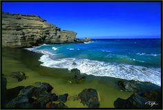 One of the 2 green sand beaches in the world.  This is Papakolea Beach on the Big Island, Hawaii.  The other is in the Galapagos Islands.