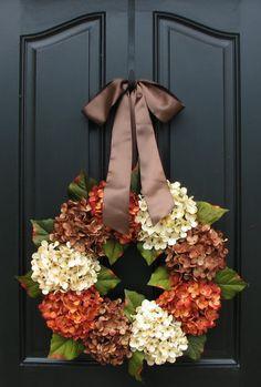 Half fall hydrangeas on a twig wreath with burlap.