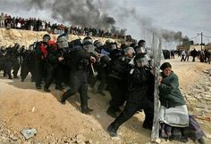 One elderly Jewish woman vs. twenty riot police, and she is holding. #BAMF