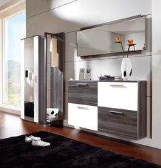 Living Room. white black cabinet living room under extensive wall mirror. Establishing Your Style With Noticeable Item From Black Cabinets Living Room