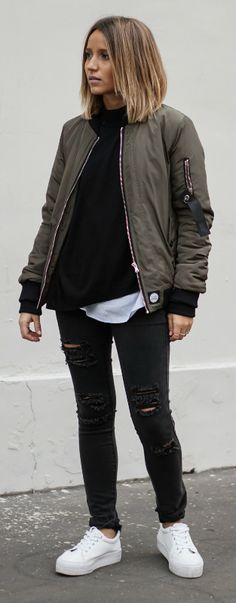 Bomber jackets will ultimately look cool over any outfit. Camille Callen wears this oversized khaki bomber with distressed denim jeans and fresh white Asos sneakers. Via Just the Design. Bomber: Sixth June, Top: Pimkie, Jumper: Sheinside, Jeans: Primark, Sneakers: Asos.