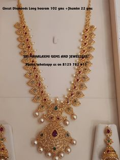 Traditional designs made with perfect finish.Fine quality pure Uncut diamonds long haaram. Beautiful long haaram  studded with uncut diamonds and pearl hangigns. Long haaram with mango hangigns. Visit for full variety at best prices. Contact no 8125 782 411. 01 May 2018