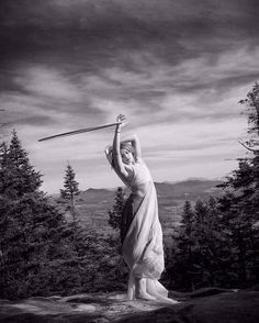 Statuesque Hooping with Hannah Stanton-Gockel. Hannah looks almost statuesque in this ethereal and unique hooping photo by Ira Musty Photography.