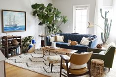 love this living room- plants, hard wood, neutrals