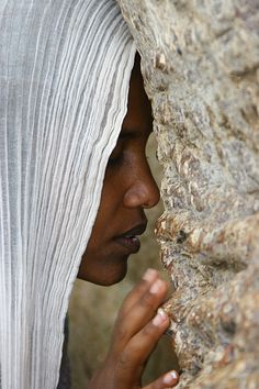 Woman praying during Festival of Mariam Dearit, Keren, Eritrea by Eric Lafforgue on Flickr.