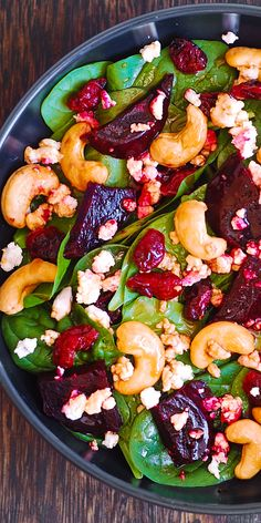 Beet Salad with Spinach, Cashews, Cranberries, and Goat Cheese with honey, lemon and olive oil dressing. #healthy #salad #beets