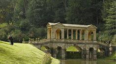 Visitors beside the Palladian Bridge at Prior Park Landscape Garden, Bath, Somerset