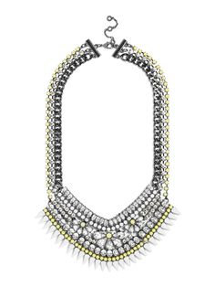 A gem-laden bib necklace combines floral motifs with edgy spikes for a fun, fresh burst of color.