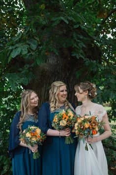 Bridesmaids wear dark blue/green maxi dresses with beading. Photography by http://jenowensimages.com/