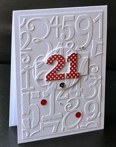 handmade birthday card from A Little Space of My Own ... clean and simple look ... Cuttlebug numbers collage embossing folder ... 21 die cut from red polka dot paper on central raised tag ... luv it!