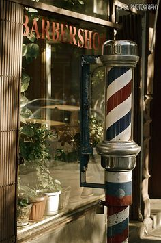 There was a Barber pole outside each barber shop to indicate men's haircuts. Barber Shop Pole, Barber Shop Decor, Barber Sign, Village Barber, Shaved Hair Cuts, Master Barber, Barbershop Design, Barber Chair, Haircuts For Men