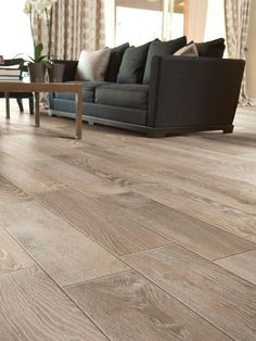 Modern Living Room Floor Tile that looks like wood .... LOVE! by corinne