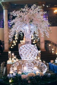 Monogrammed ice sculpture centerpieces are perfect for winter weddings via www.southernbrideandgroom.com