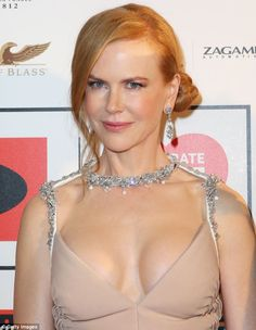 Dangerously low: Miss Kidman, 46, hosted a charity ball in a low-cut Prada gown that showe...