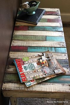 Pallet Furniture -- coffee table in waiting area or viewing area -- like the different colors -- could use with my logo colors -- or even do long stripes like that with logo colors for reception desk