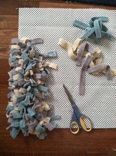 Cut small strips of towels (about 8-9″ long) in a variety of colors or a single color (whatever you want to do). Snip a small hole in the rug grip material and slide the strip of towel through and tie a knot. Repeat until you have a finished bath mat.