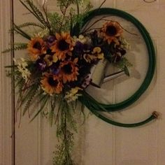 Hose wreath I made for a friends birthday gift with her favorite flowers, pansies, sunflowers & Queen Anne's lace.