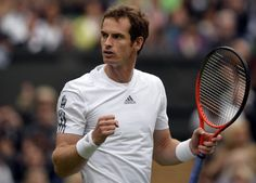 Britain's Andy Murray celebrates beating Germany's Benjamin Becker during their men's first round match on day one of the 2013 Wimbledon Championships tennis tournament at the All England Club in Wimbledon, southwest London, on June 24, 2013. Murray won 6-4, 6-3, 6-2
